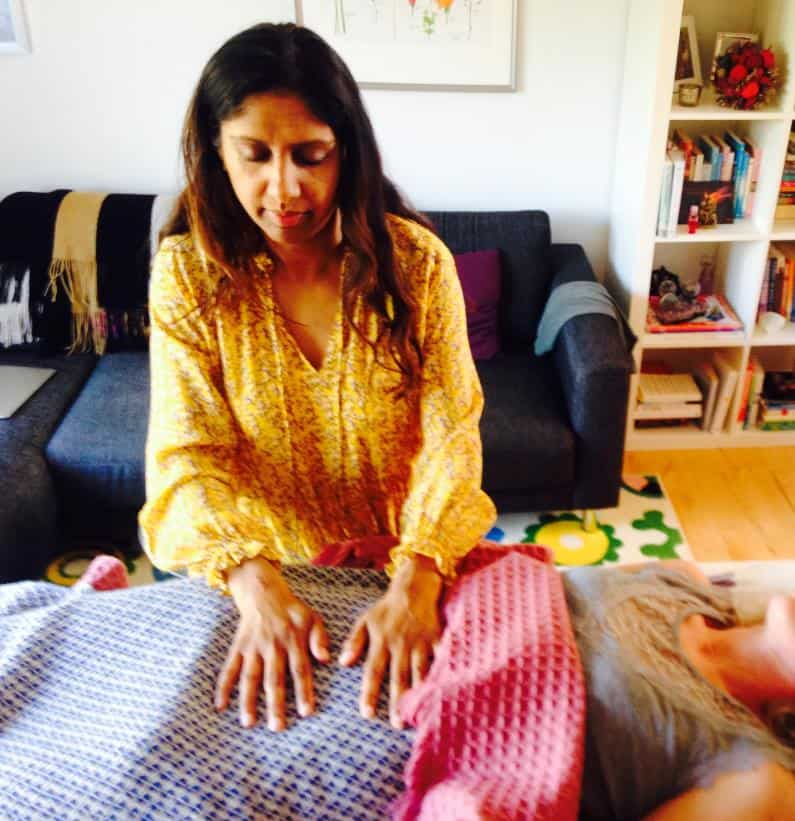 Lakshmih Moon giving womb healing to a client